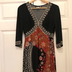 Mid length patterned dress, stretchy flared.